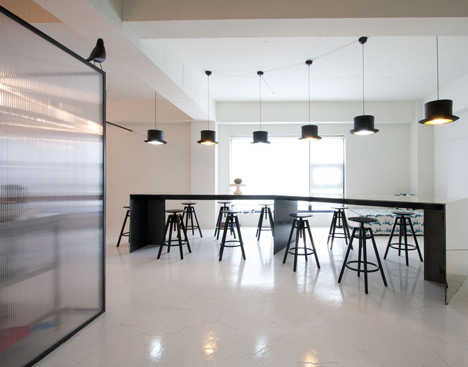 Interesting Office Kitchen Design With Black Granite Backsplash